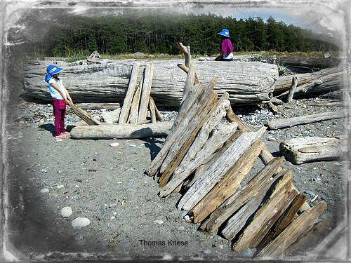 girls building fort on beach 2